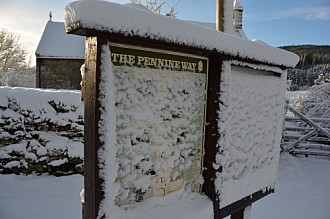 Pennine Way sign in winter