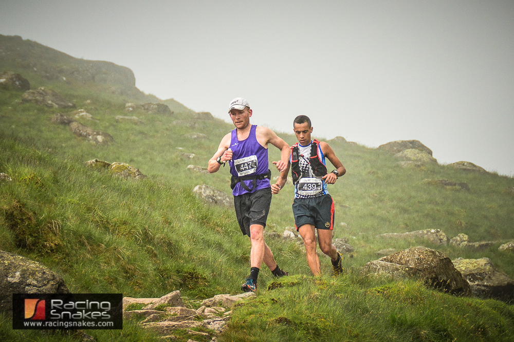 Kim Collison leads Cristofer Clemente off scafell pike